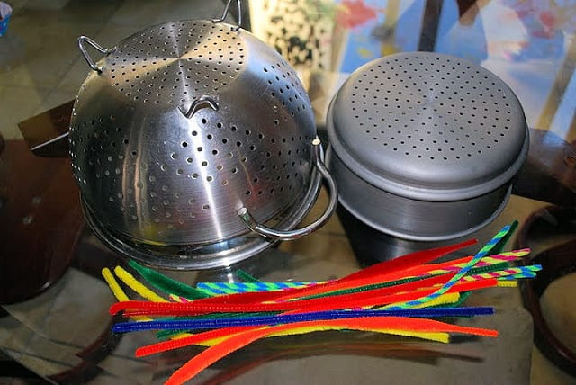 fine motor skills activity with a collander