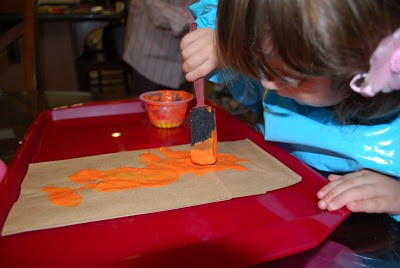 painting a paper bag pumpkin