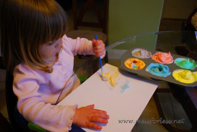 child painting with shaving cream