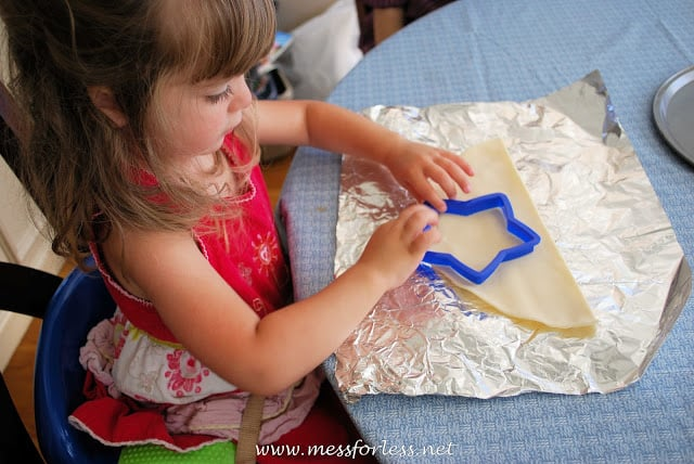 Child with cookie cutter