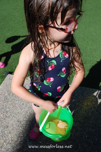child with water balloons