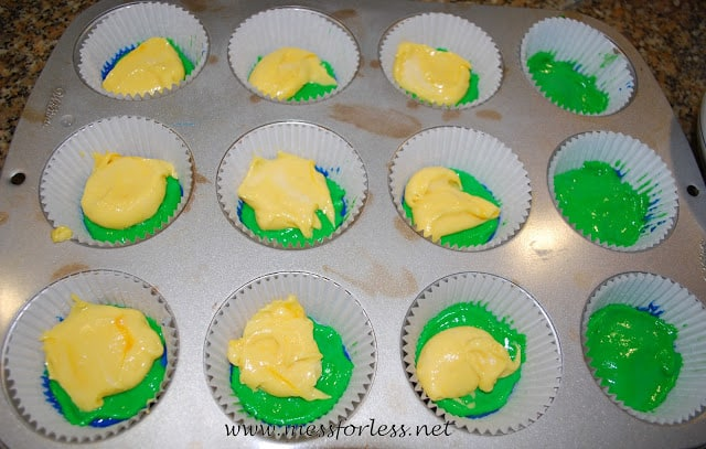 cupcake lines with cupcake batter