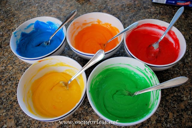 adding food coloring to cake batter
