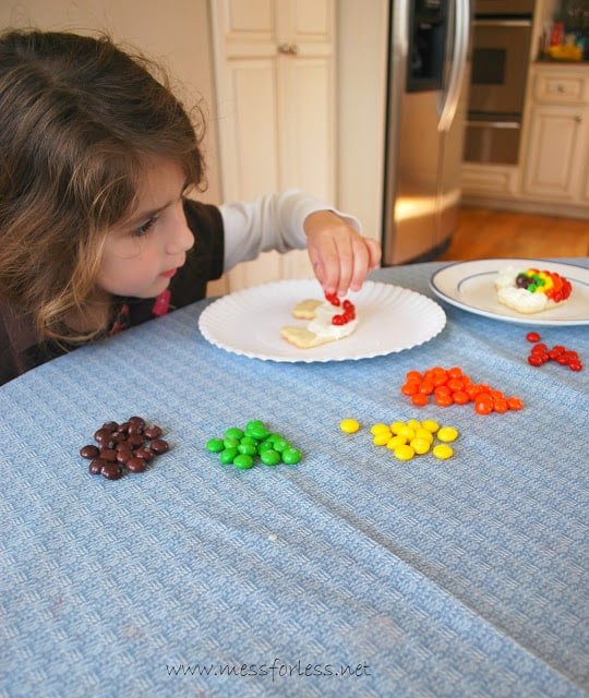 Decorating rainbow cookies