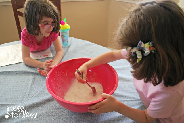 kids mixing ingredients for bread