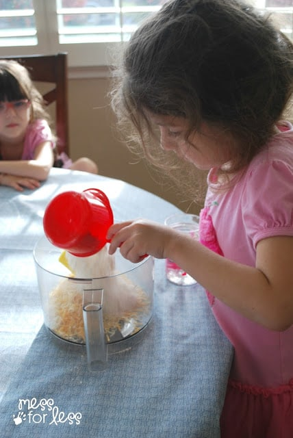 child making cheese cracker recipe
