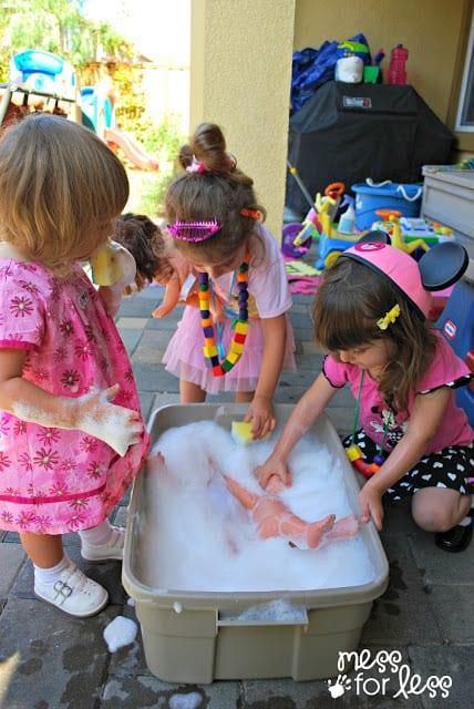 Giving dolls a bath