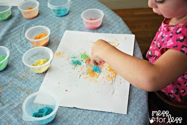 Kids use glue and crushed cereal to make art.