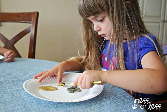 child painting rocks