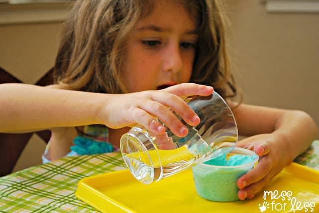 Pouring vinegar on lotion dough