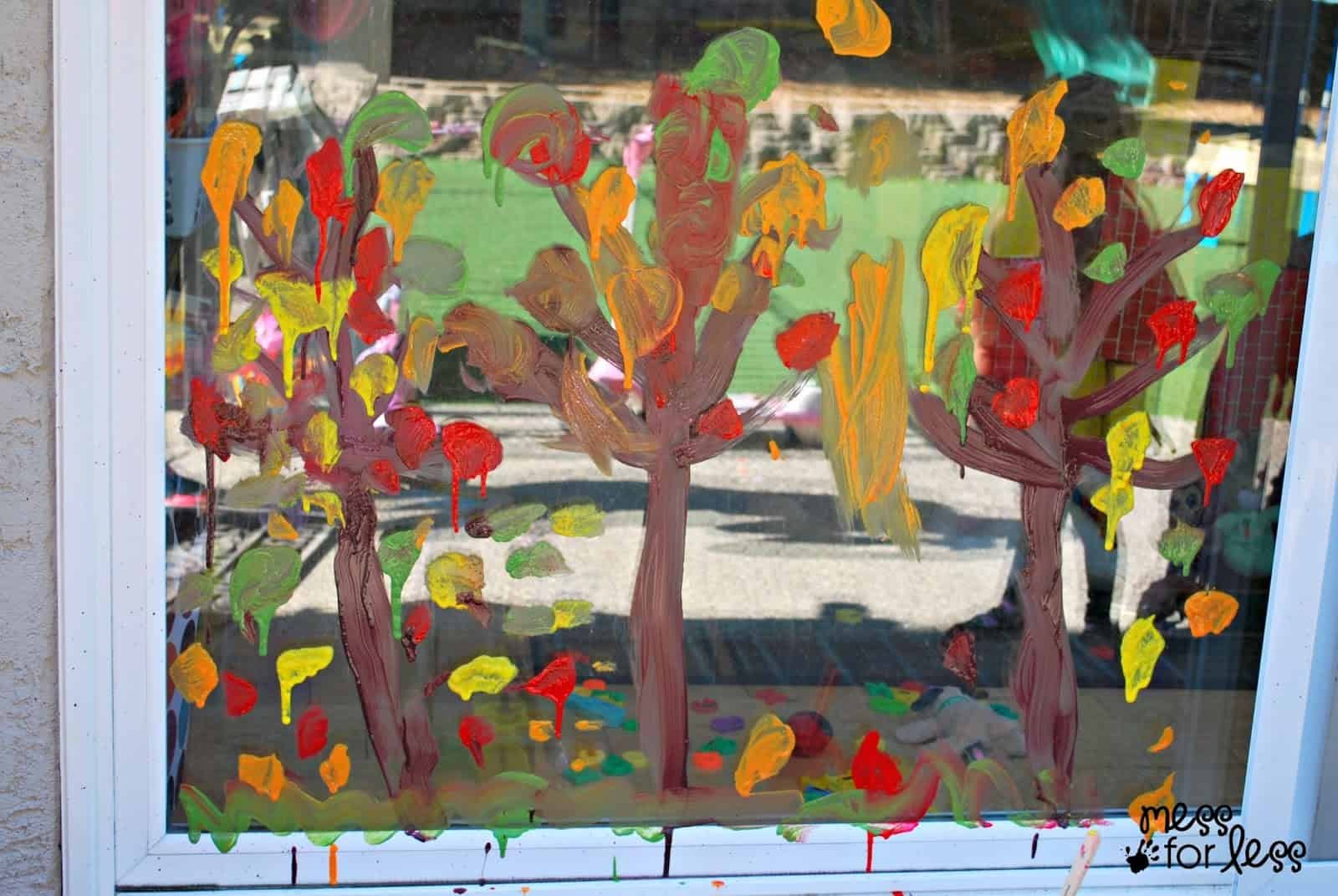 Fall tree window painting mess for less for A mural is painted on a
