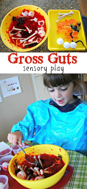 Gross Guts Sensory Play - add some Halloween toys to red Jell-o to create a squishy, slimy play experience.