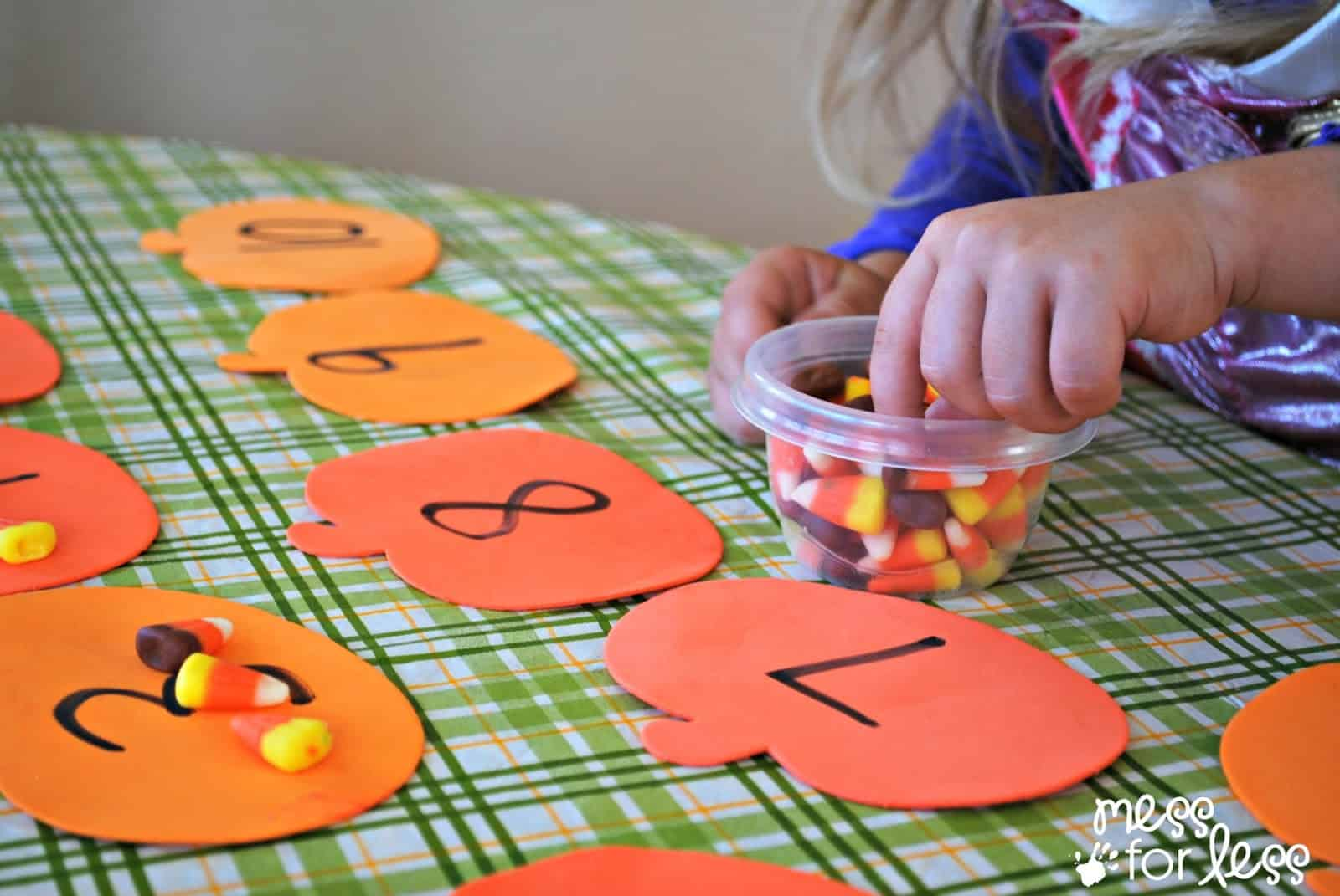 halloween activites candy corn counting  mess for less candy corn math game