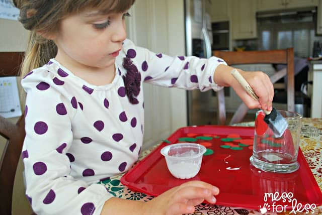 decorating a Christmas craft