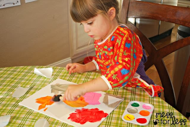 child painting a canvas
