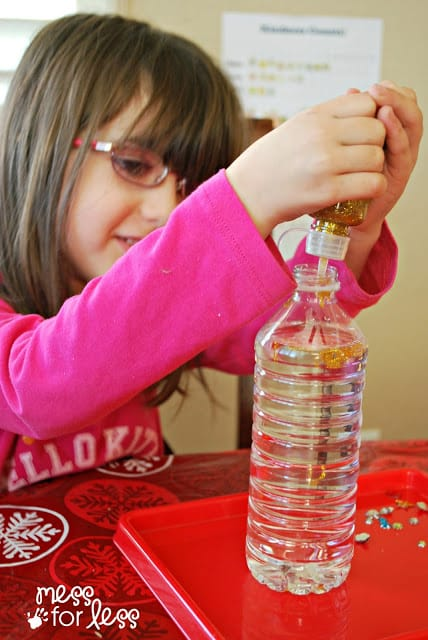 child making a glitter bottle