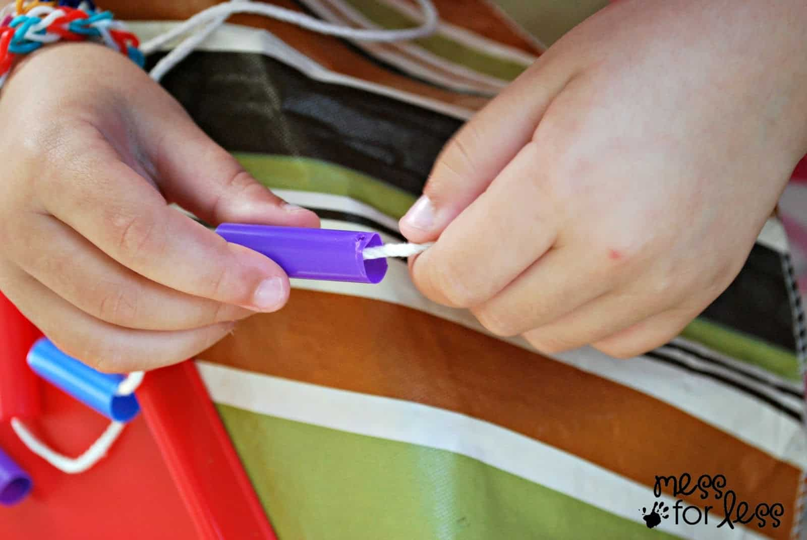 placing straws on a string