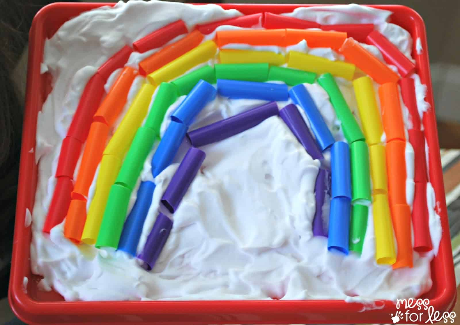 Making a sensory rainbow with straws