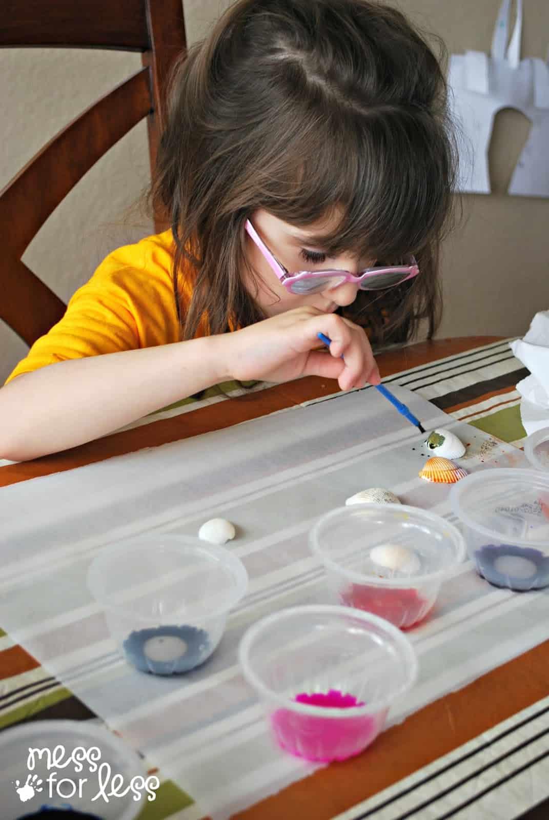 child painting seashells