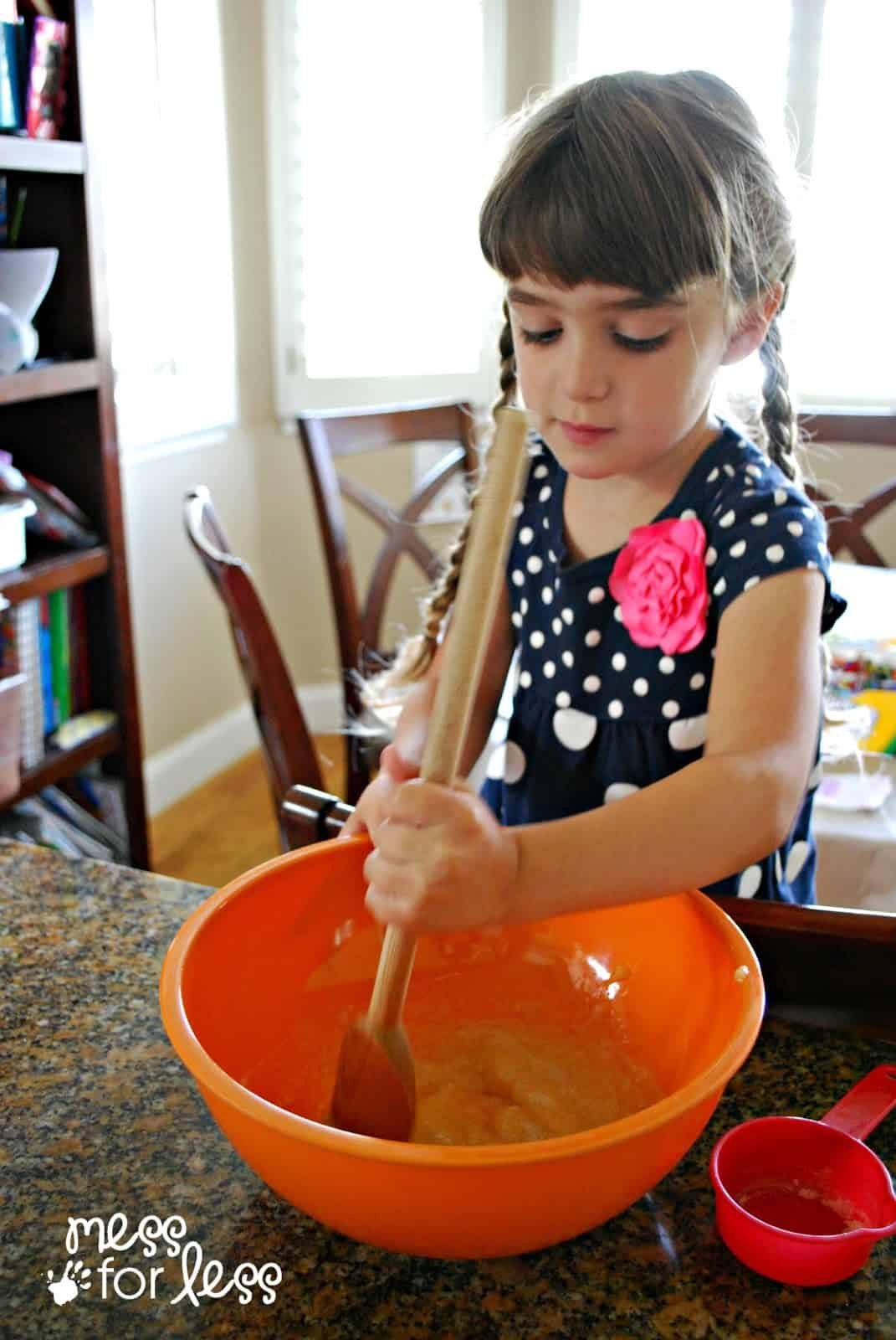 child making banana bread