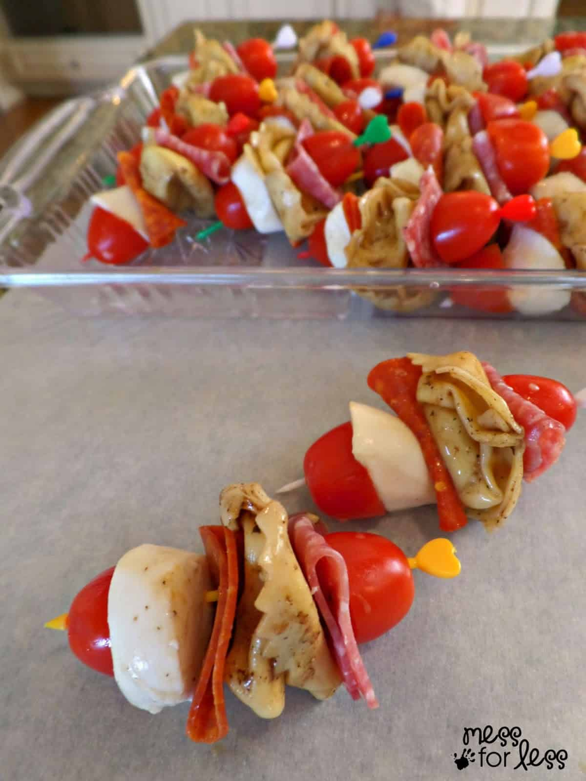 Italian Appetizers - These Tortellini Salad Skewers are perfect for your next gathering. Each bit is filled with yummy Italian flavors!