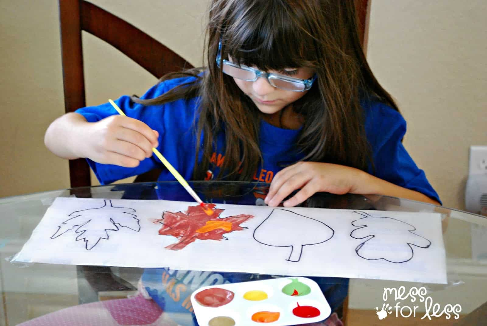 child painting fall leaves