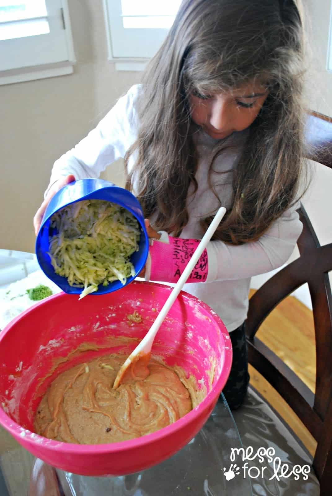 child helping to make a zucchini bread recipe