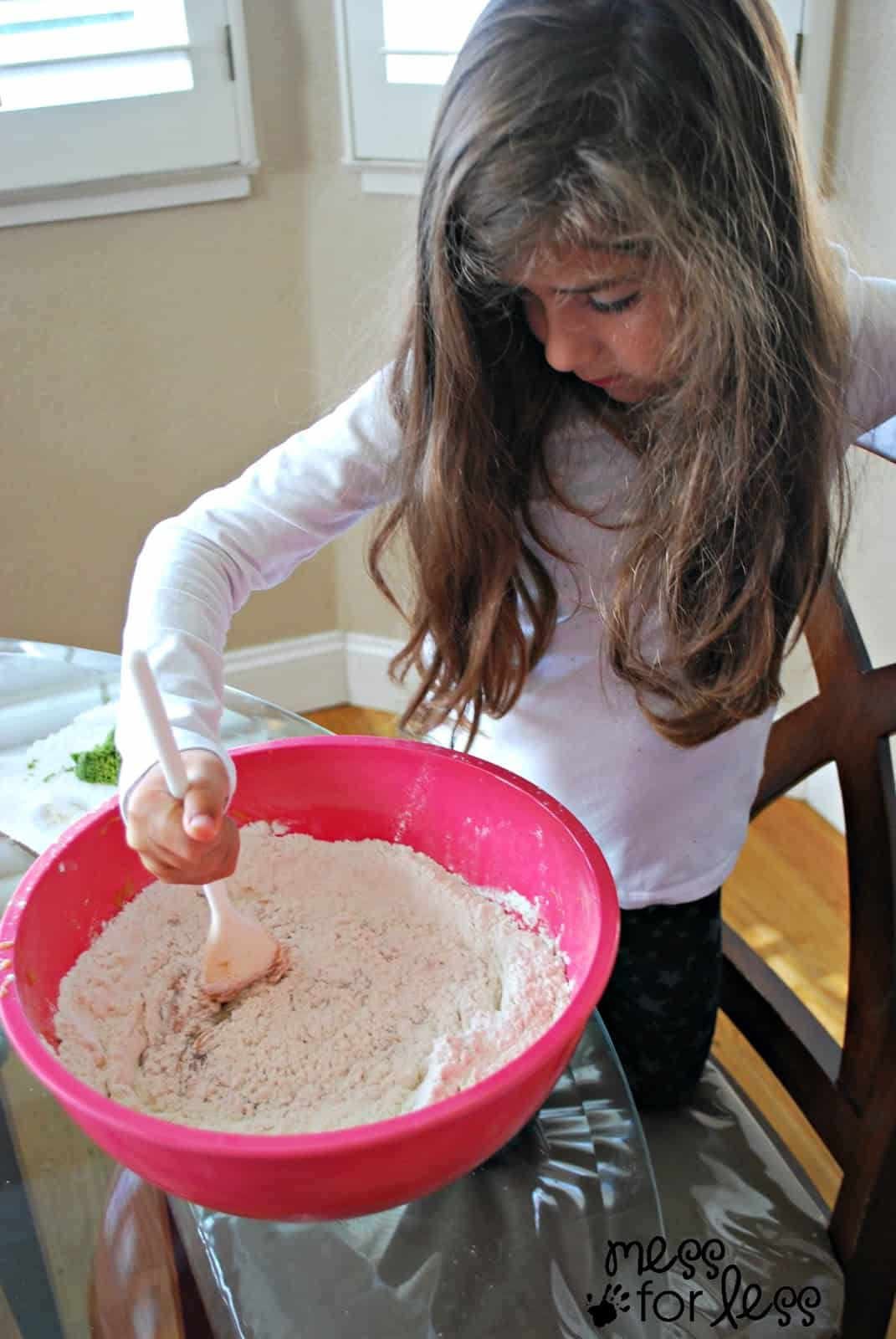 child making zucchini bread