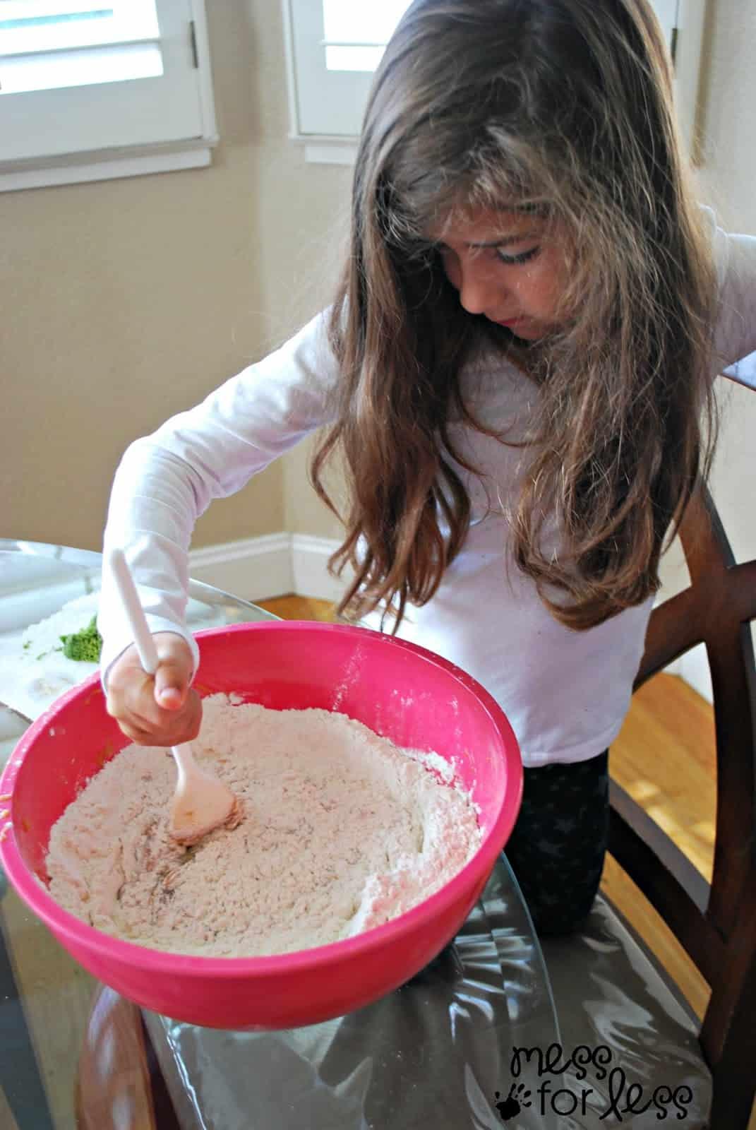 child making zucchini bread