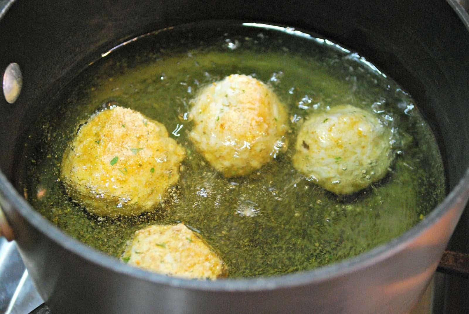 frying rice balls in oil