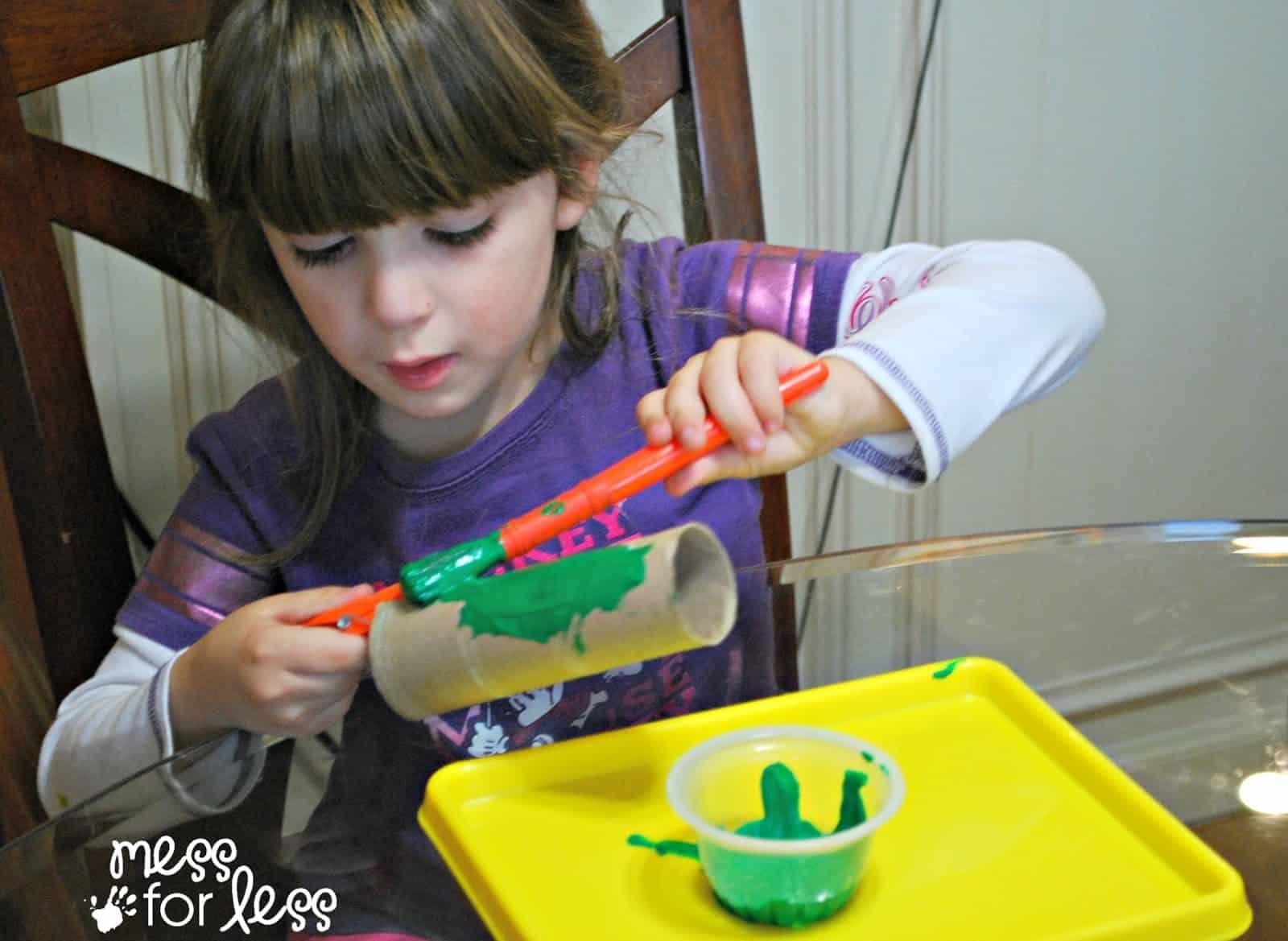 child painting cardboard tube