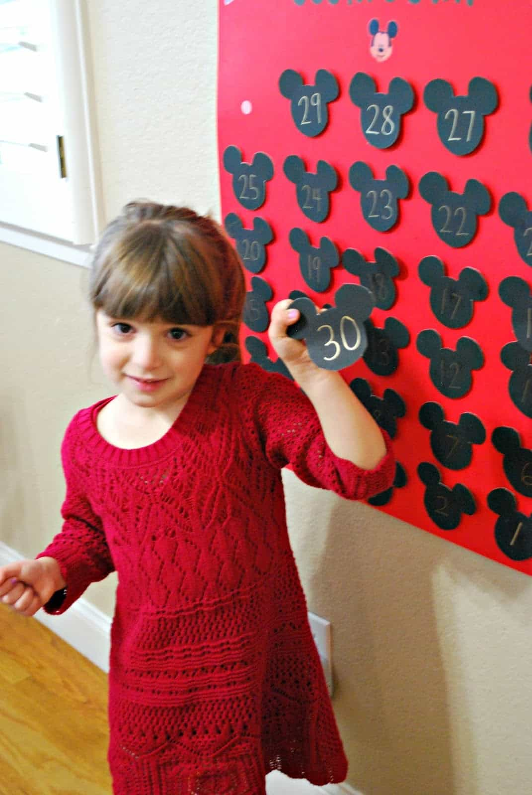 child using a Disney World Countdown calendar