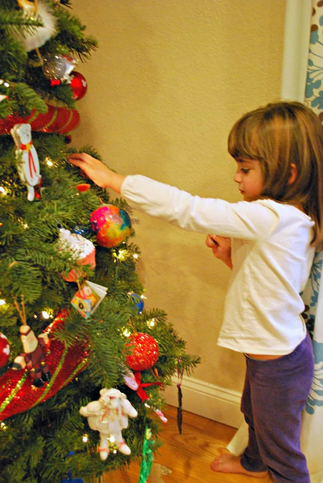 child decorating tree
