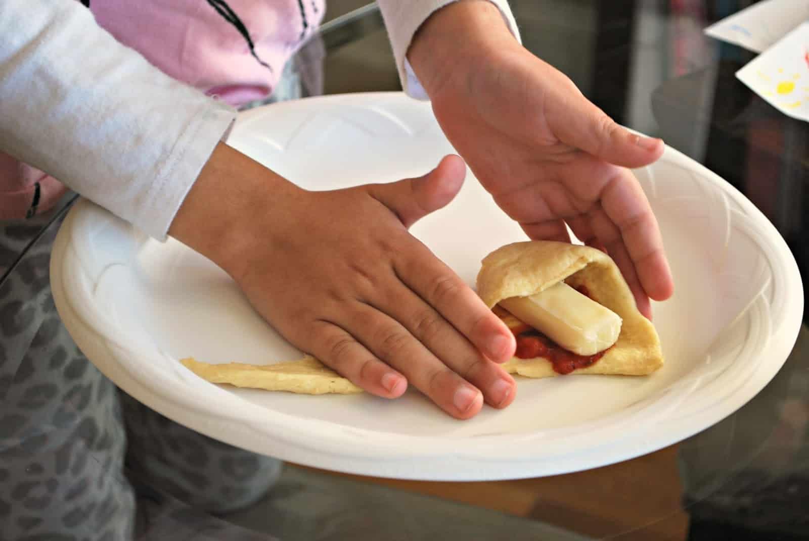 child making pizza crescents