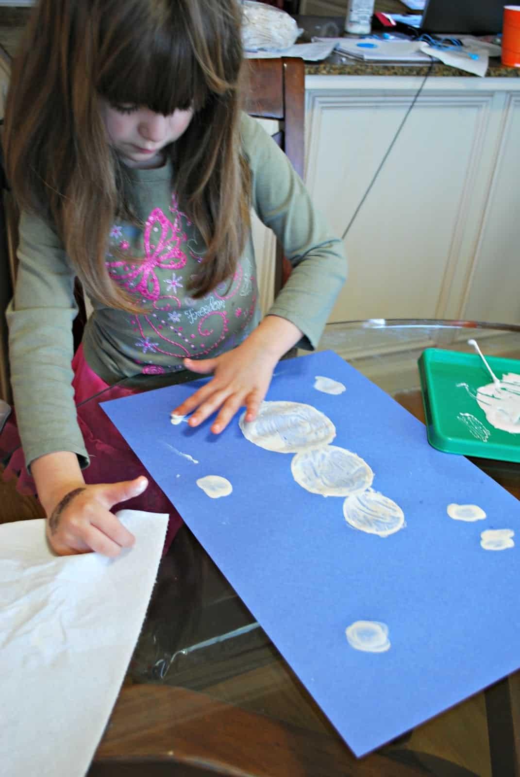 child making a snowman craft