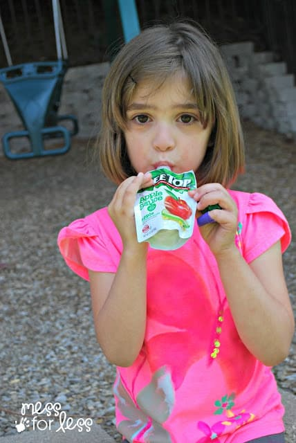 Child eating Tree Top Apple Sauce #RaisingGoodApples AD