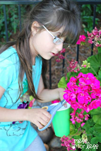 child cutting flowers