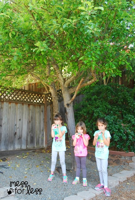 kids under an apple tree