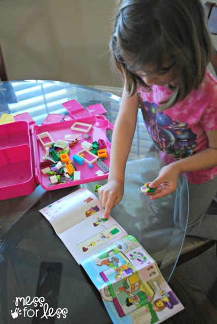 child playing with Lego #LEGOSummer #CleverGirls #sponsored