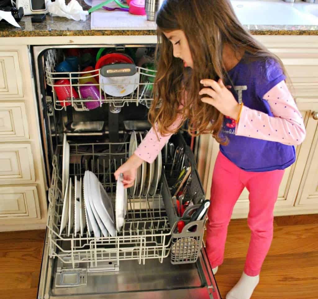 child-helping-with-dishwasher