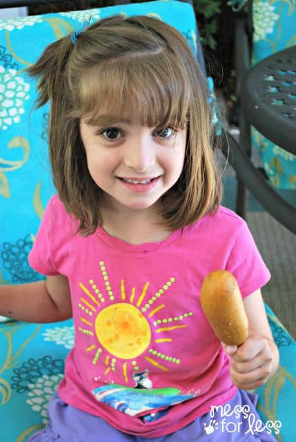 child-eating-corn-dog