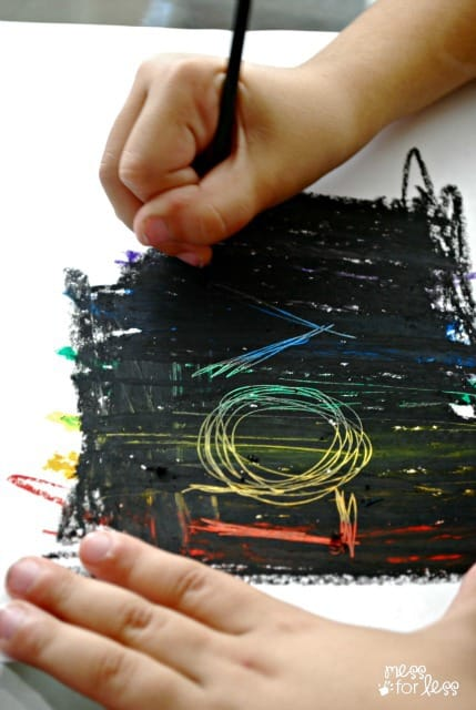 kids making scratch art