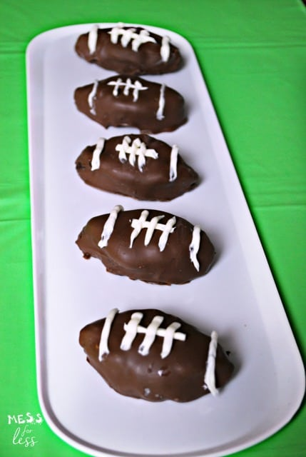 These football brownie truffles will be the hit of your party! This smooth, rich chocolate treat is perfect for a game day celebration! sponsored #MixUpAMoment