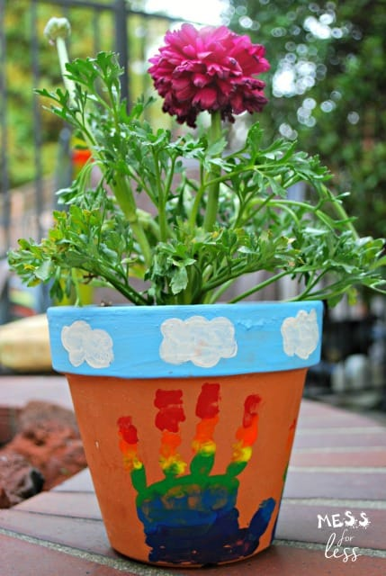 Made this rainbow hand print flower pot with the kids and it was so easy and turned out beautifully. What a great keepsake. #ad #HugTheMess