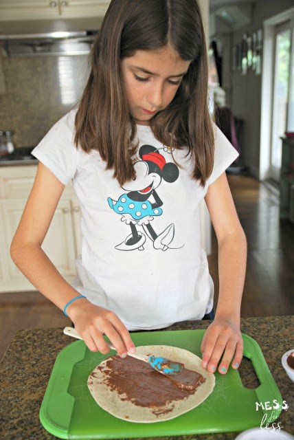 spreading nutella on a tortilla