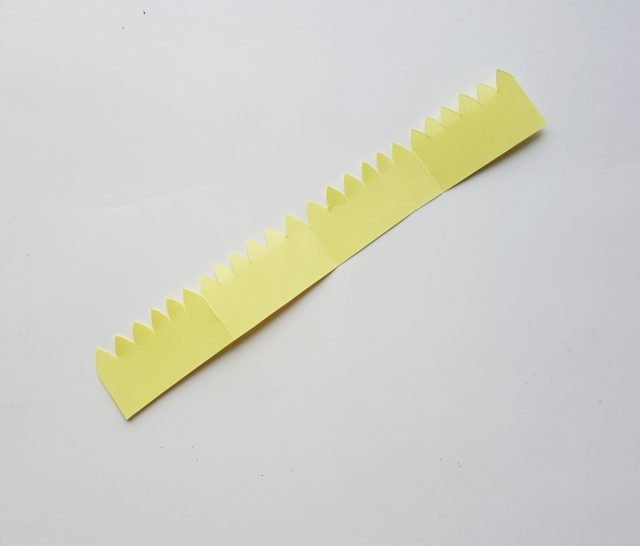 yellow paper strip for a paper flower craft