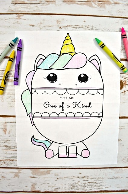 unicorn coloring sheet with message and crayons