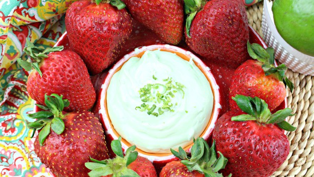 Key Lime Cheesecake Dip surrounded by strawberries