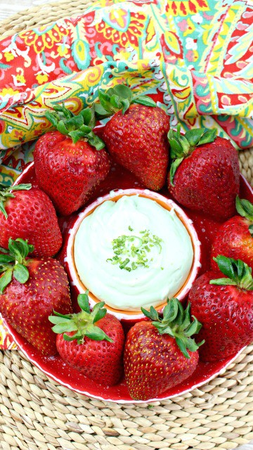 easy key lime dip in a bowl with strawberries