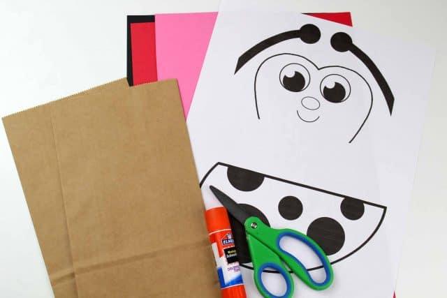 supplies to make a paper bag ladybug